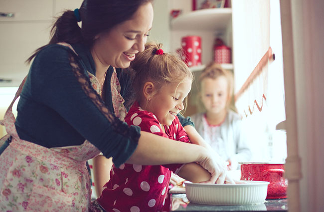 mom baking together with children