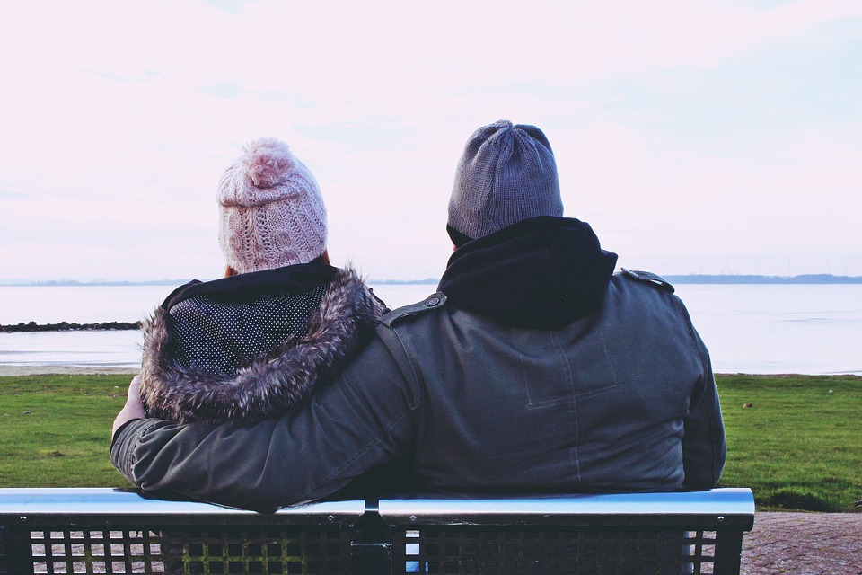 couples sitting in a bench
