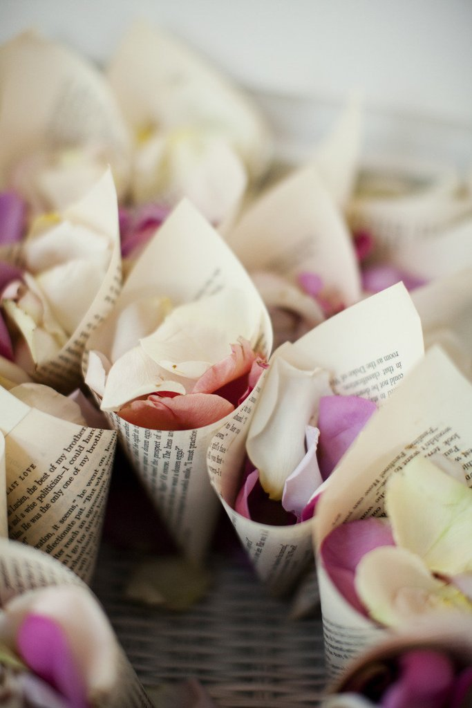 flowers at a cone shaped paper - wedding cones