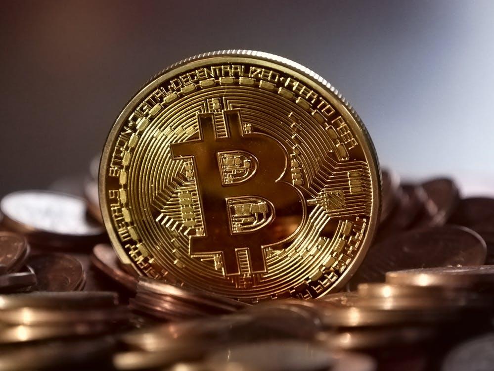 a gold coin with a bitcoin logo